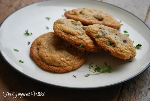 4 chocolate chips cookies with thyme on a plate