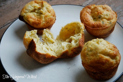 sourdough popovers with nutmeg and black pepper on plate, with one broken open