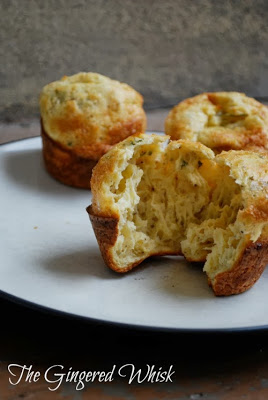 sourdough popovers on plate with one split open