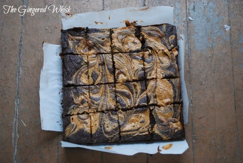 Chocolate Stout & Peanut Butter Swirled Brownies cut into 16 squares on parchment paper