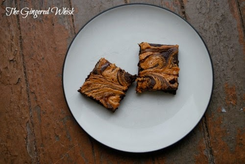 overhead view of two Chocolate Stout & Peanut Butter Swirled Brownies on white plate