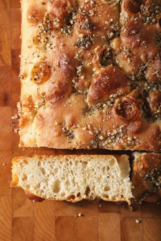 focaccia bread on wooden rack