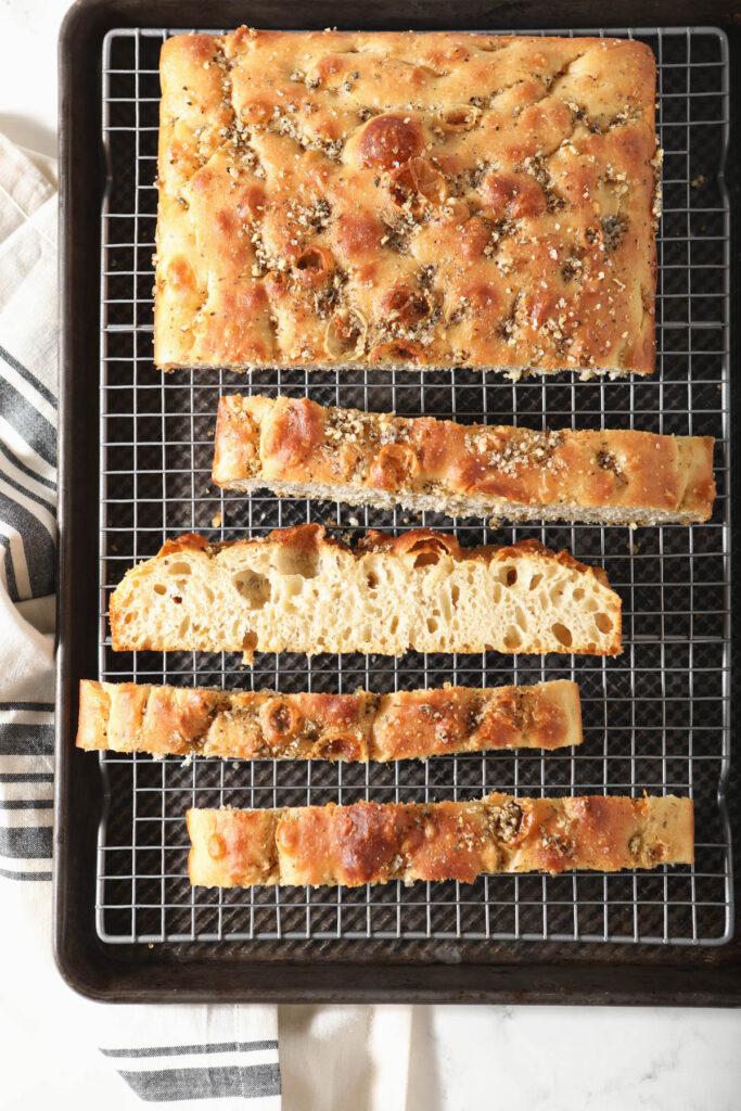 sourdough focaccia slices on cooling rack