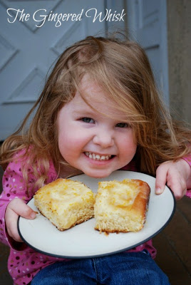A little girl with plate of lemon cream cheese sweet rolls