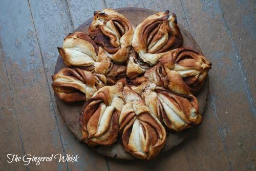 twisted cinnamon sweet bread on circle baking sheet