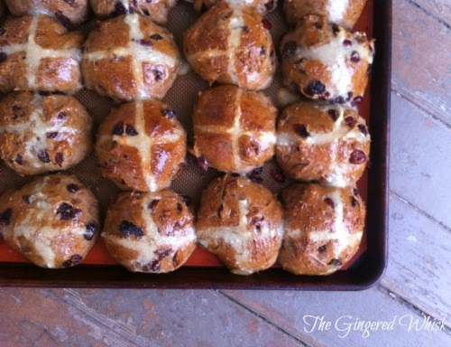 hot cross buns made with sourdough on baking tray