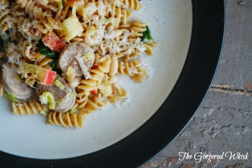 plate with pasta, chicken sausage, and apples