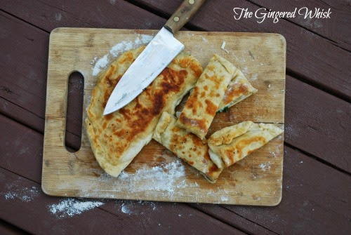 gozleme on cutting board with slices and knife