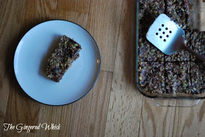 glass baking dish with homemade granola beside plate with granola bar
