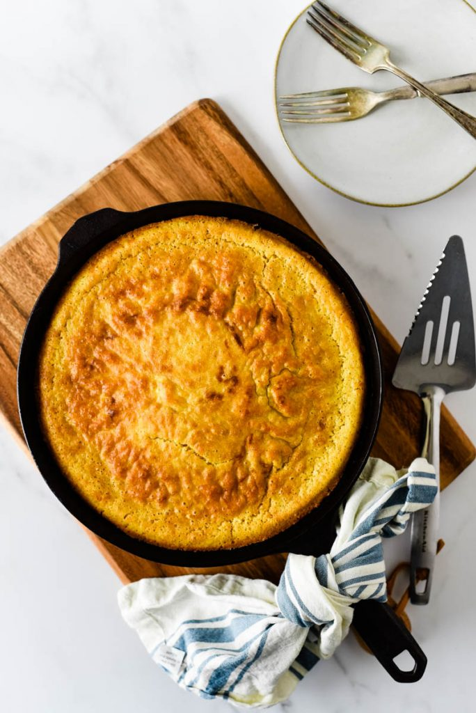 overhead view of cast iron skillet with cornbread