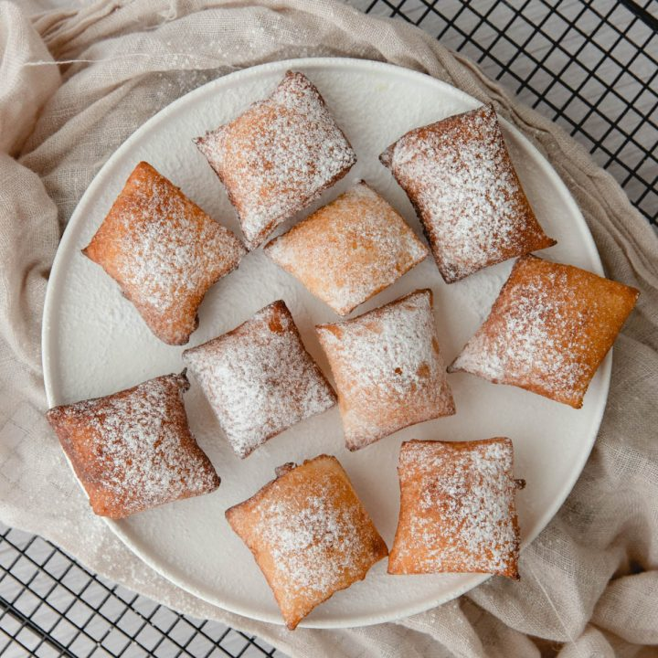 freshly made sourdough beignets on platter