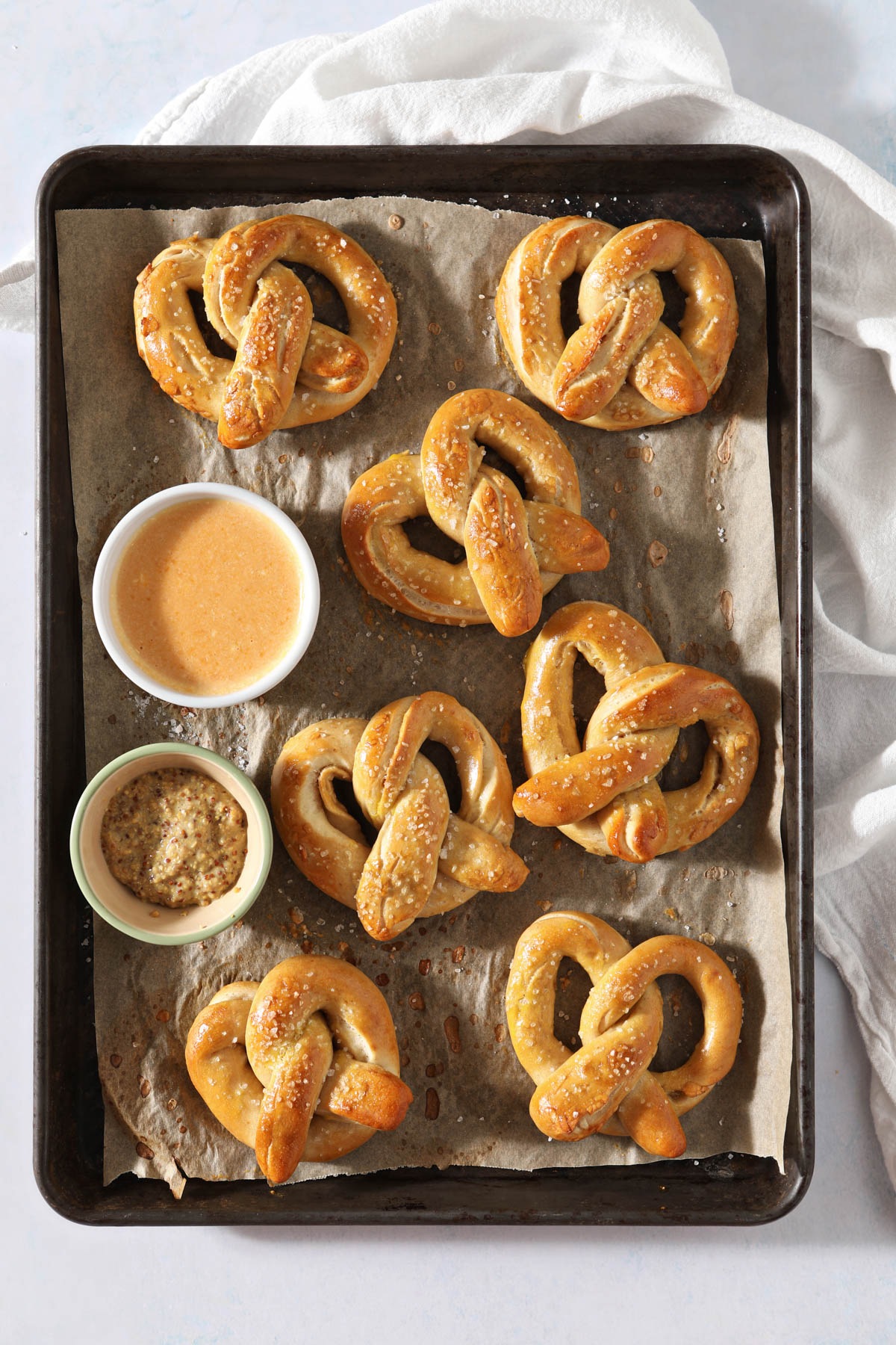 sourdough pretzels on tray with mustard beside