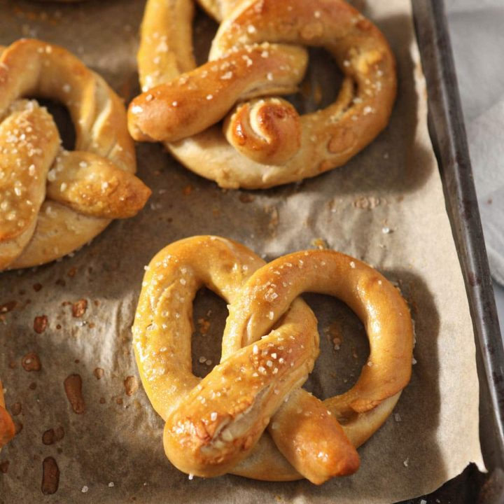 close up of sourdough pretzels on baking tray