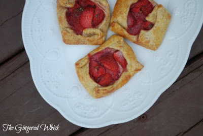 overhead view of three strawberry galettes on white plate