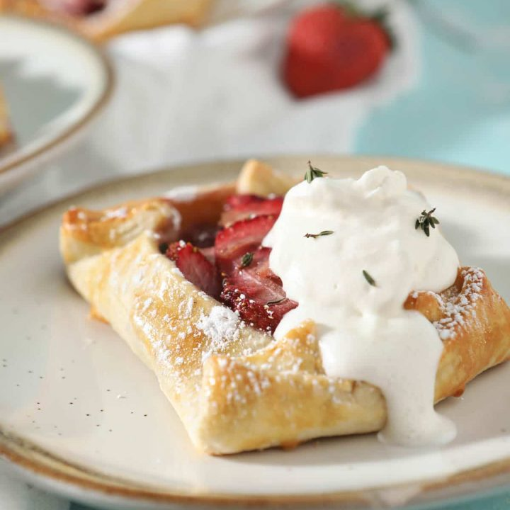 strawberry galette with whipped cream on top