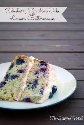 slice of blueberry and zucchini cake with lemon frosting on plate