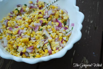 salsa made with sweet corn and red onions in bowl