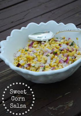 sweet corn salsa in white bowl with spoon