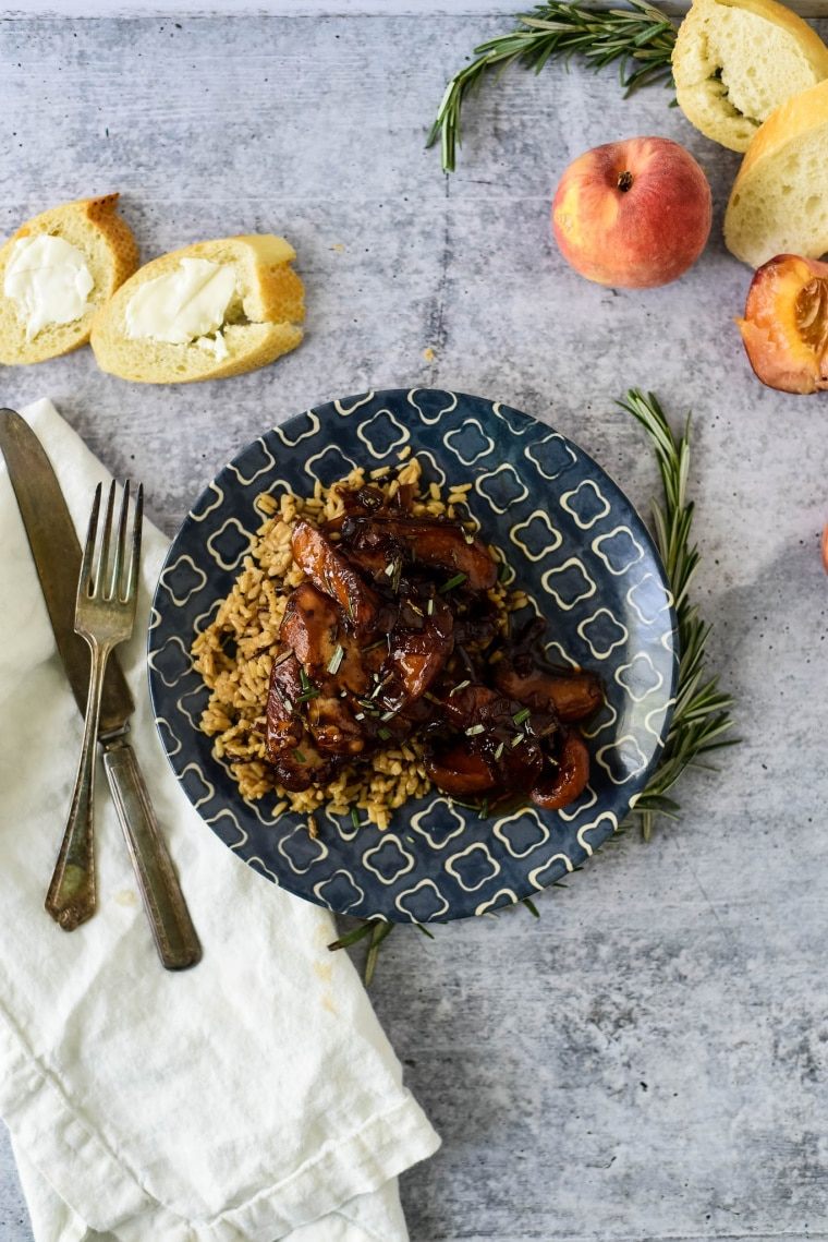 peach balsamic chicken on plate with brown rice