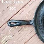 cast iron skillet sitting on wooden planks