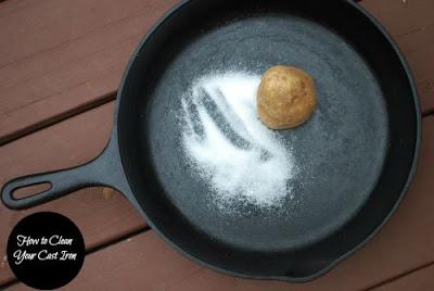cast iron skillet with salt and half a potato