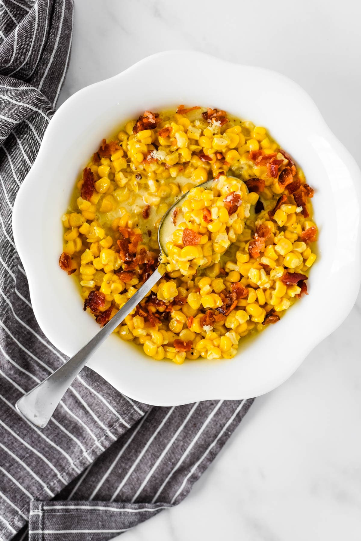overhead view of white bowl with old fashioned creamed corn
