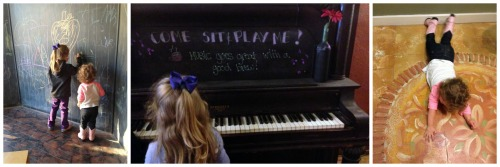 a small girl sitting at a piano