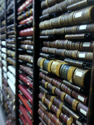 close up of bindings of old books on a shelf