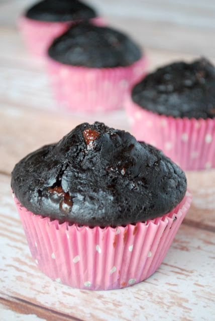 double chocolate zucchini muffins in pink paper wrappers