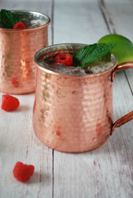 raspberry moscow mule in copper cup with mint leaves