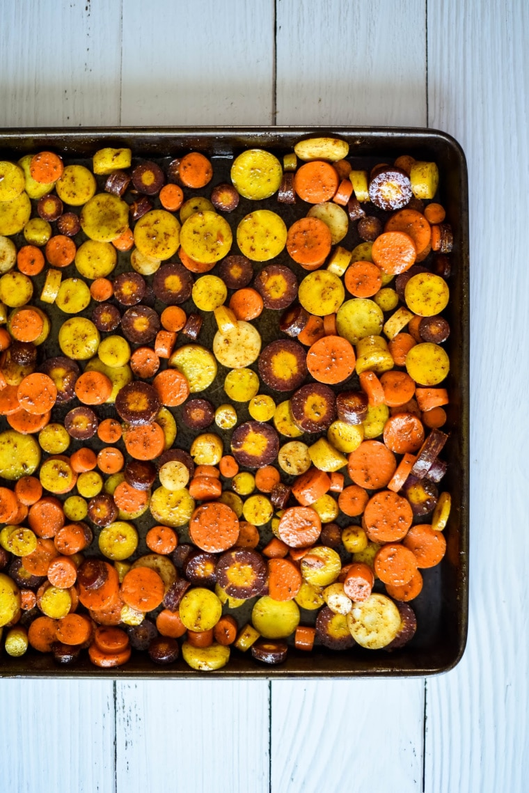 rainbow carrot slices on sheet pan before roasting
