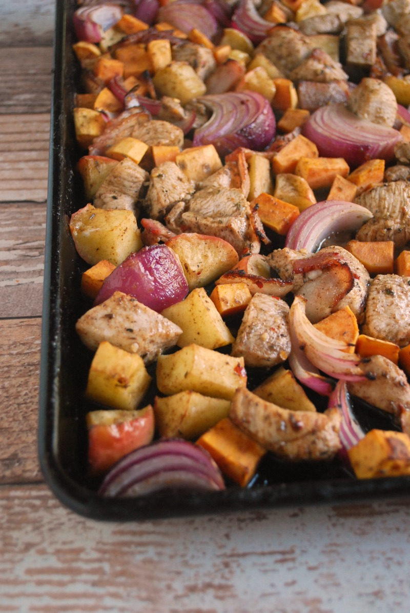 baking tray with diced onions, chicken and sweet potatoes to be roasted