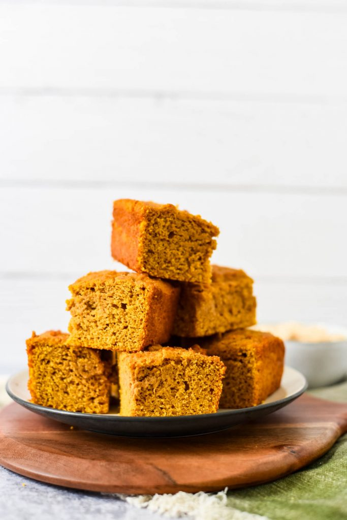 platter with stack of pumpkin cornbread squares