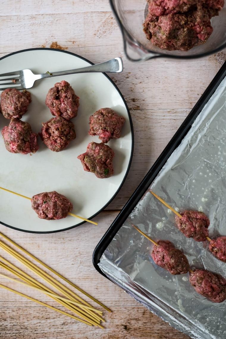 forming beef kofta onto skewers
