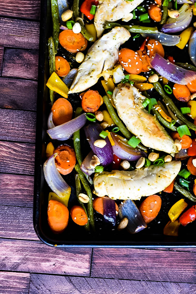 baking pan with chicken and rainbow vegetables