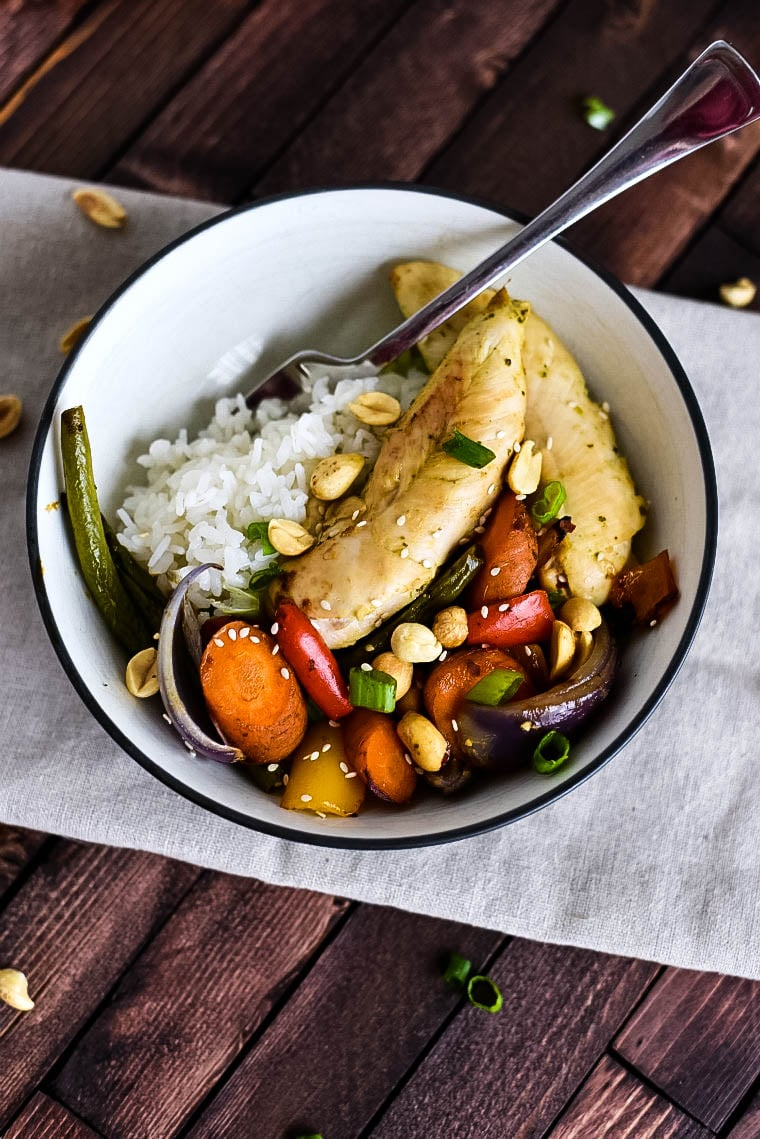 Bowl with sheet pan chicken and vegetables with kung pao sauce