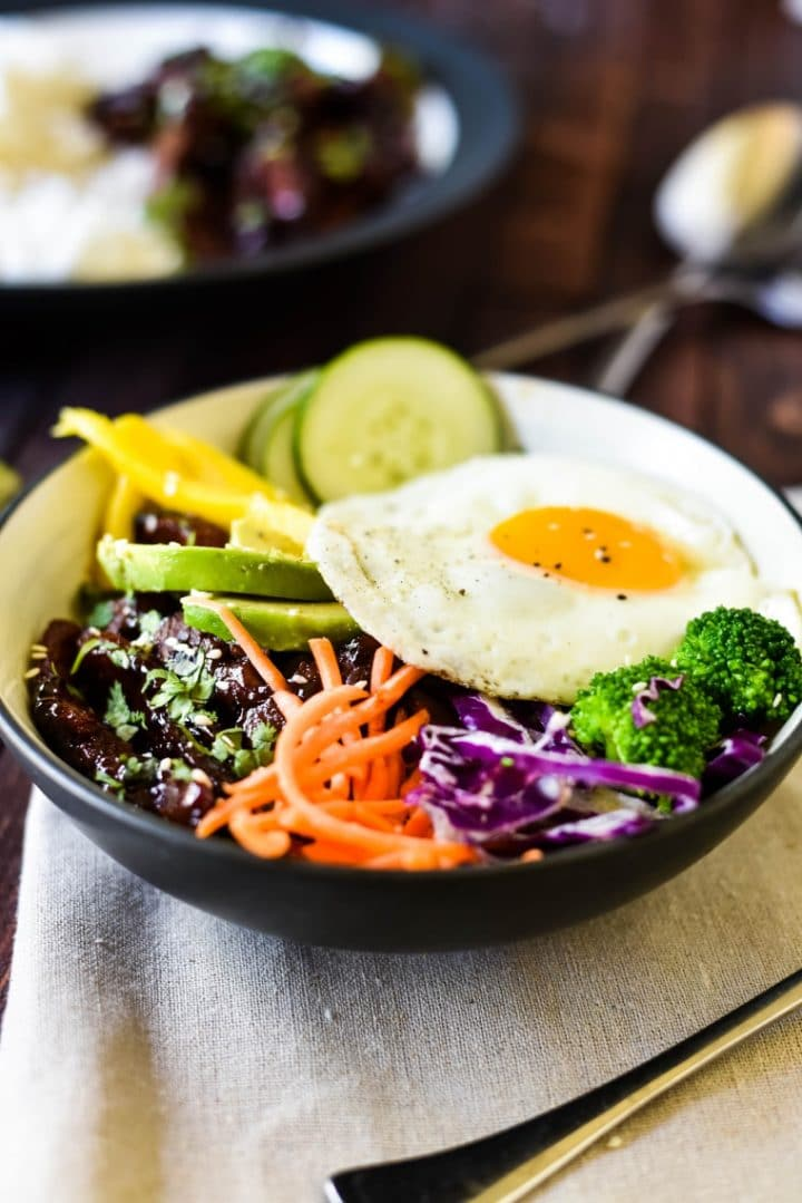bulgogi beef in bowl with toppings