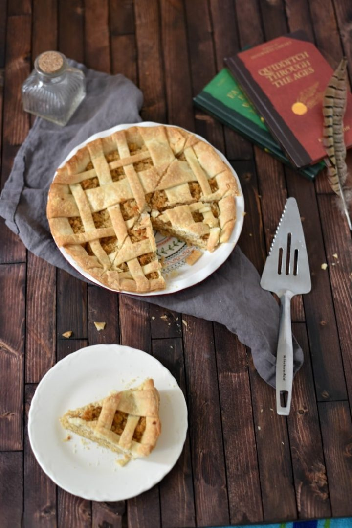 treacle tart on plate and in pie plate with serving spatula and books beside