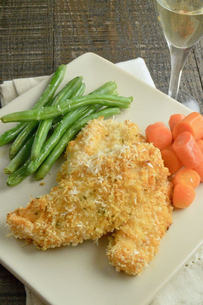Dressed Up Chicken is an easy weeknight dinner recipe your family will love. Marinated/dipped in salad dressing, coated with parmesan herb panko then baked until crispy. Both Kids and adults alike will enjoy it!