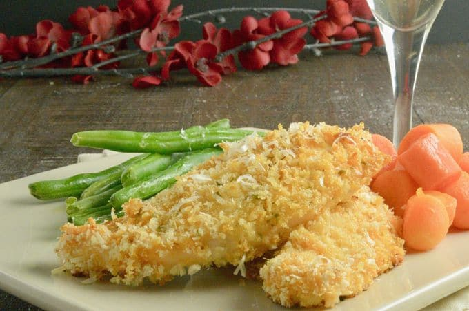 Dressed up Chicken on a plate with carrots and green beans for dinner