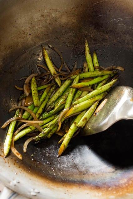 fry asparagus in wok