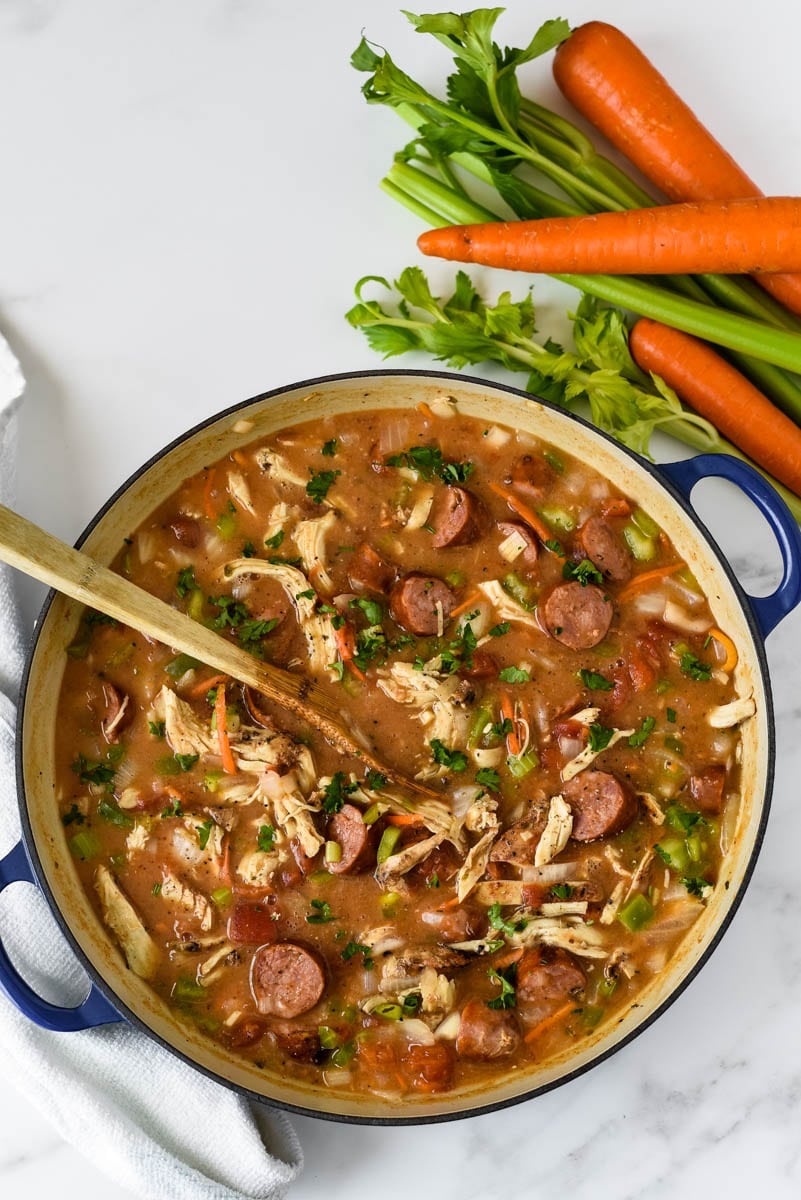 blue cooking pot with chicken sausage gumbo