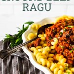 pin image of beef ragu on white platter with overlay text