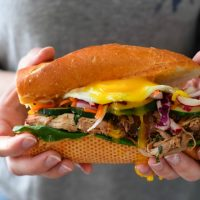 Pulled Pork Banh Mi Recipe with Pickled Slaw and Topped with an Egg