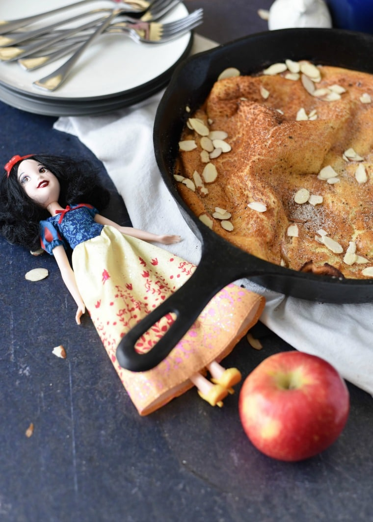 Snow White Doll next to skillet of dutch baby pancake