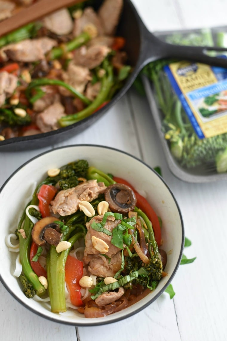 Thai Pork with Broccolini in a cast iron skillet