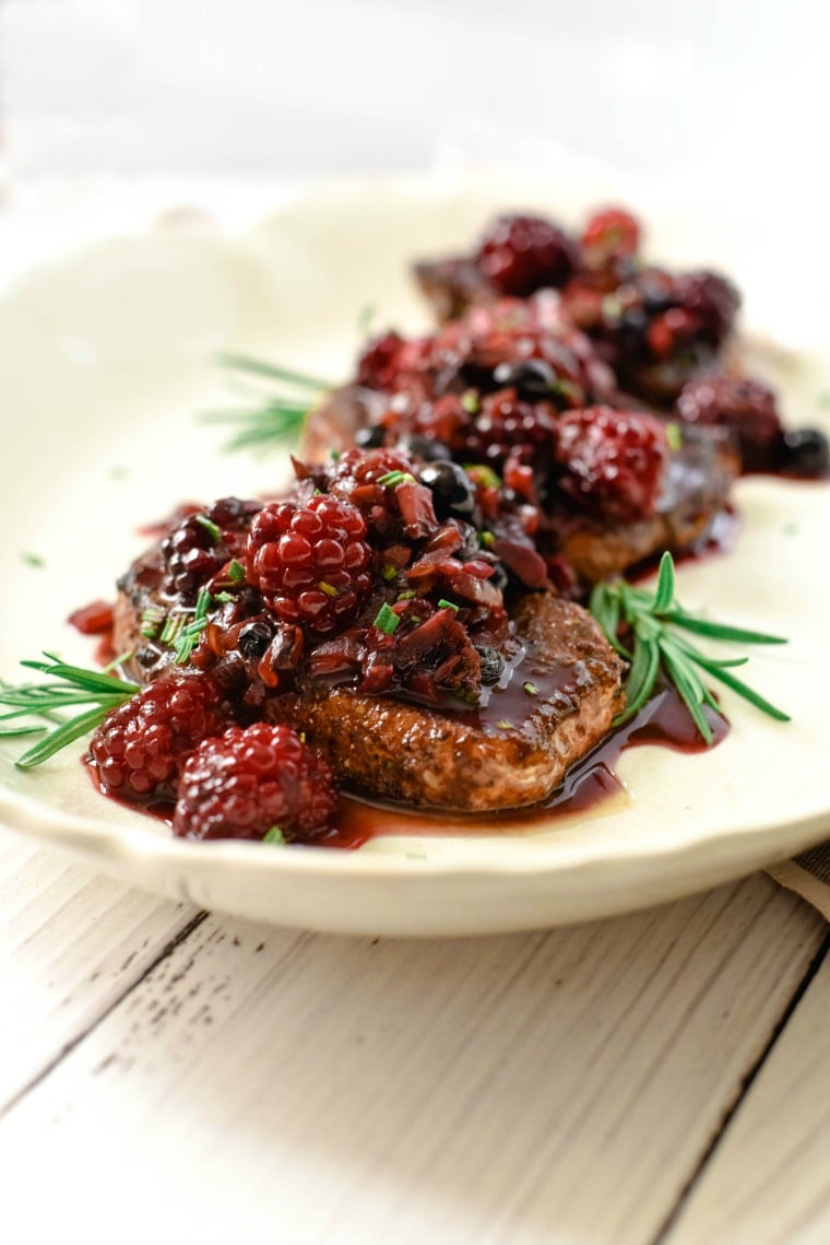 Pork Chops with Rub and Berry Sauce on Plate
