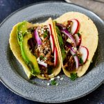 chicken mole tacos on blue plate