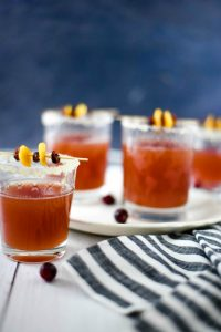 Cranberry Orange Cocktail in four cups on a plate