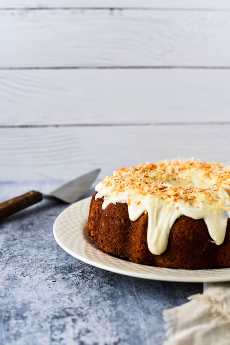side view of coconut bundt cake with toasted coconut on top